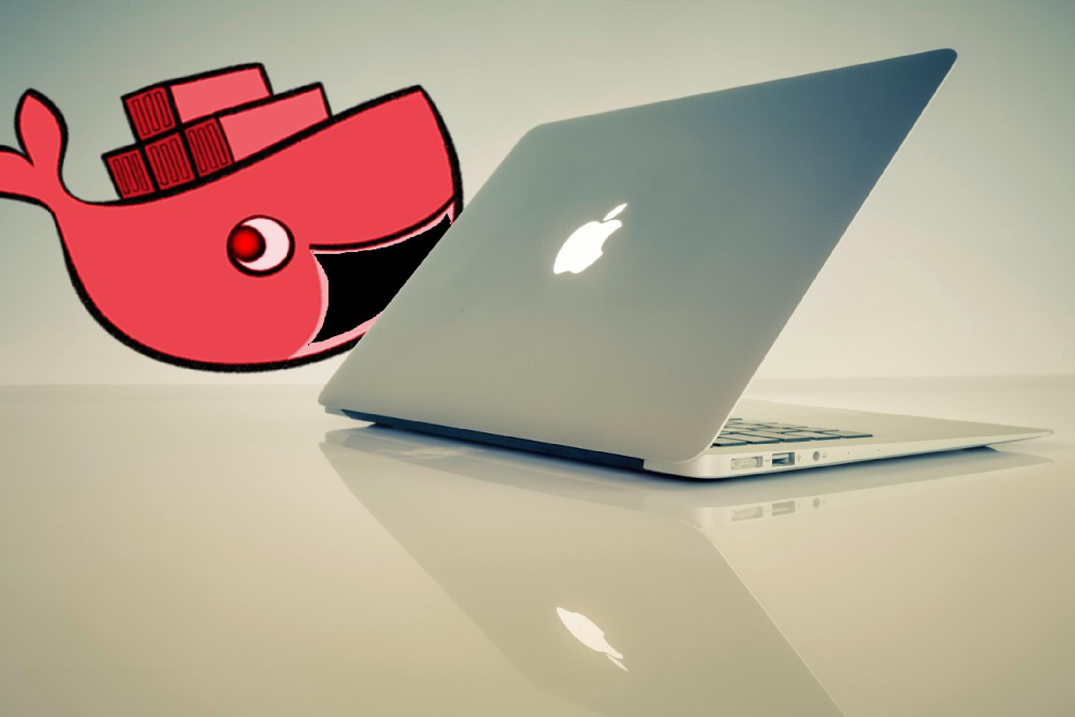a semi-open MacBook Pro sitting inconspicously on a table with a cartoon drawing of a whale threatening to swallow it in the background